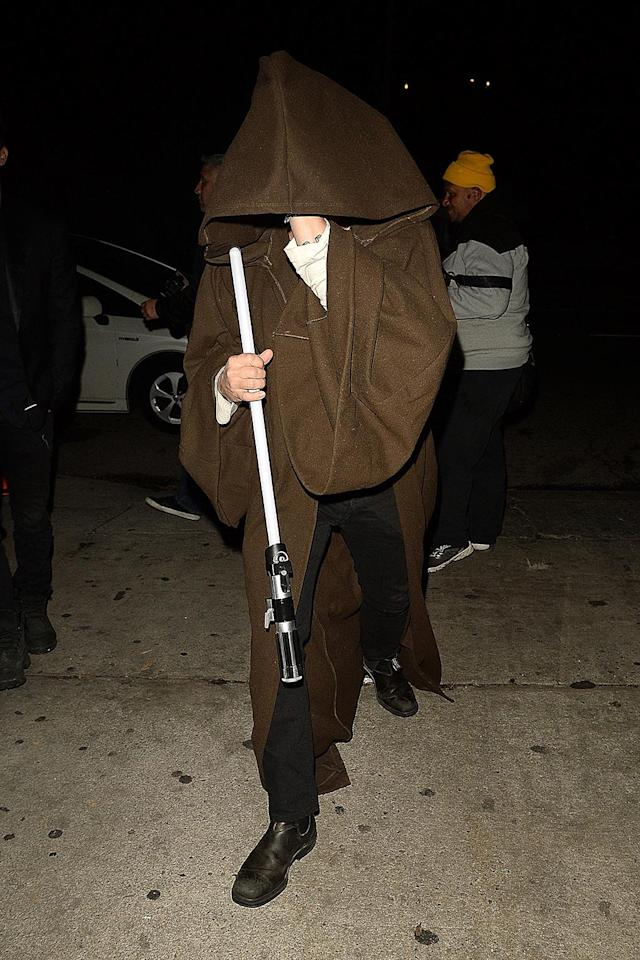 <p>The <i>Star Wars</i> fan kept a seriously low profile at a Halloween party in Hollywood. Look at that light saber! (Photo: AKM-GSI) </p>