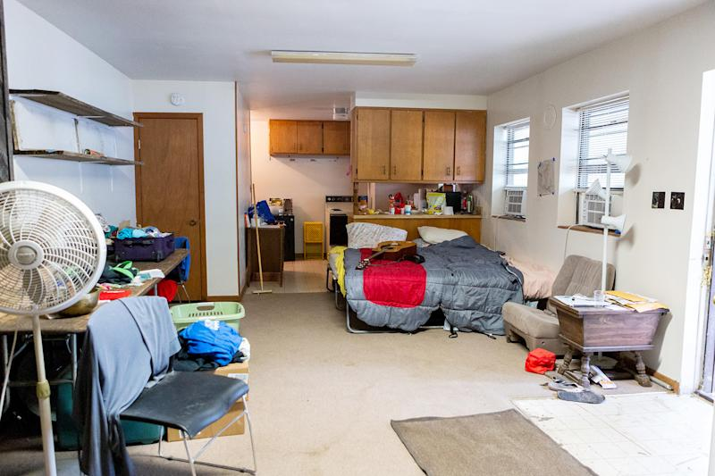 dated and disorganized apartment main area