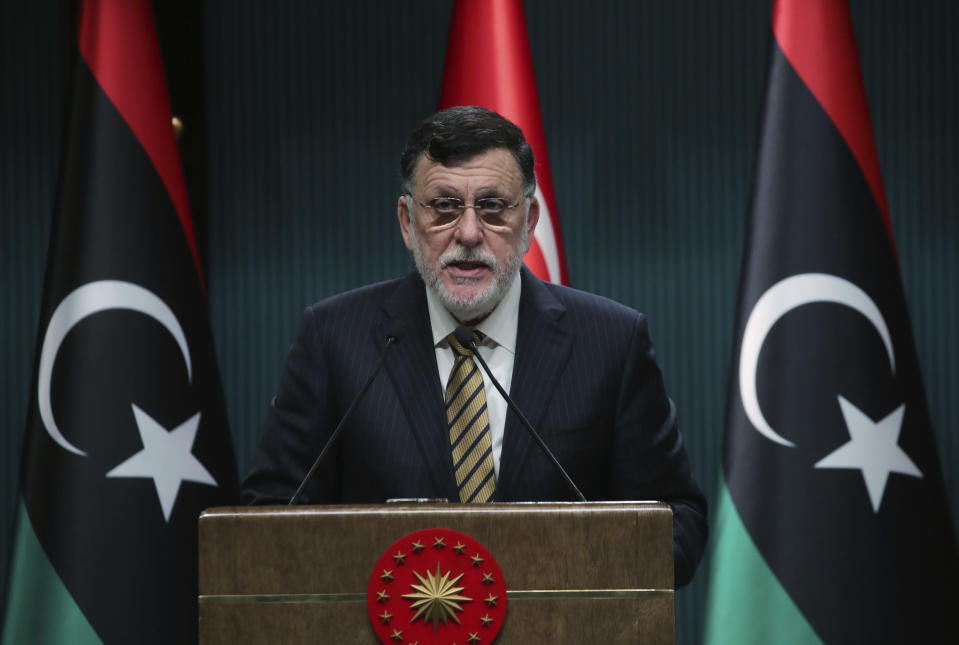 FILE - In this June 4, 2020 file photo, Fayez Sarraj, the head of Libya's internationally-recognized government, speaks at a joint news conference with Turkey's President Recep Tayyip Erdogan, in Ankara, Turkey. Libya's U.N.-supported government Friday, Aug. 21, 2020, announced a cease-fire across the oil-rich country and called for demilitarizing the strategic city of Sirte, which is controlled by rival forces. (Turkish Presidency via AP, Pool)