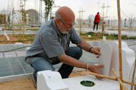 """Algerian artist Rachid Koraichi said he set up the Jardin d'Afrique cemetery to give """"a first taste of paradise"""" to migrants who died trying to reach Europe"""
