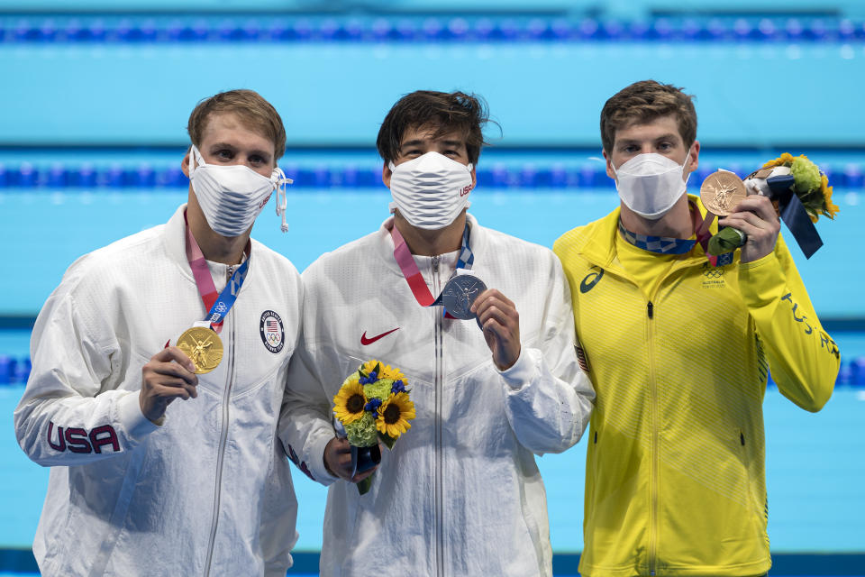 Chase Kalisz, Jay Litherland and Brendon Smith pose with their medals wearing masks after the men's 400m individual medley final during the Tokyo 2020 Olympic Games.