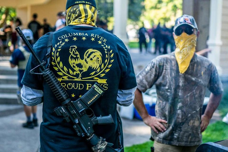 Mr Trump's dangerous rhetoric includes seemingly telling far-right group the Proud Boys to 'stand by' (Getty Images)