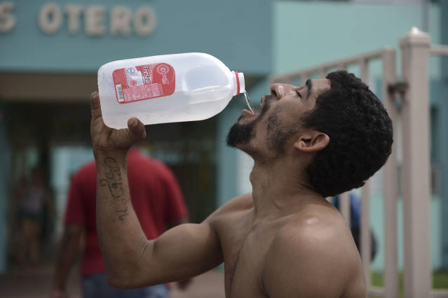 <p>Julio Ortiz Montanez drinks water at the Jose Robles Otero Elementary School after the passing of Hurricane Maria, in Toa Baja, Puerto Rico, Friday, Sept. 22, 2017. Because of the heavy rains brought by Maria, thousands of people were evacuated from Toa Baja after the municipal government opened the gates of the Rio La Plata Dam. (Photo: Carlos Giusti/AP) </p>