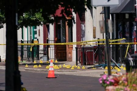 Evidence markers rest on the ground after a mass shooting in Dayton
