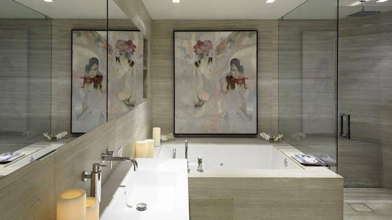 The Mass bathroom also features a Jen Mann oil painting, 'Flora and Fauna.' It is enclosed in a glasslike box to protect it from humidity.