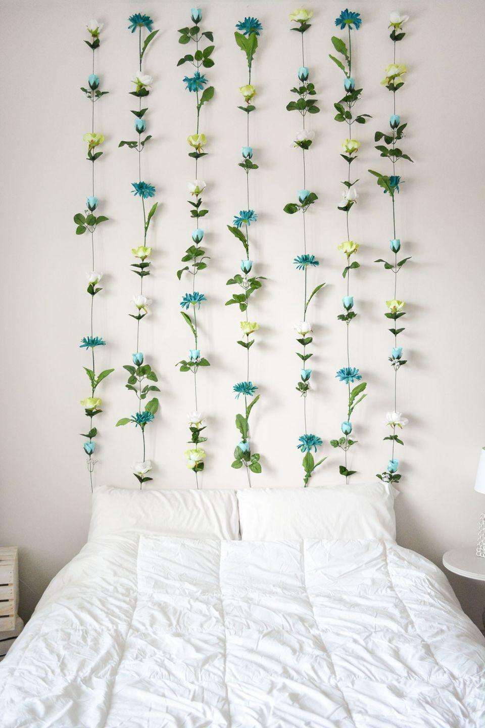 "<p>Who needs a <a href=""https://www.housebeautiful.com/room-decorating/bedrooms/g717/headboard-designs/"" rel=""nofollow noopener"" target=""_blank"" data-ylk=""slk:headboard"" class=""link rapid-noclick-resp"">headboard</a> when you can have a full-on wall of flowers? Total boho goals. Get the tutorial at <a href=""http://sweetteal.com/2016/07/diy-flower-wall/"" rel=""nofollow noopener"" target=""_blank"" data-ylk=""slk:Sweet Teal"" class=""link rapid-noclick-resp"">Sweet Teal</a>.</p>"