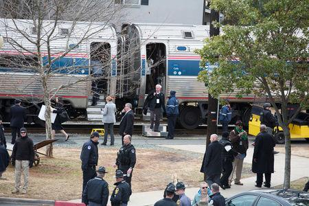 Train carrying US Republicans hits truck, killing one person