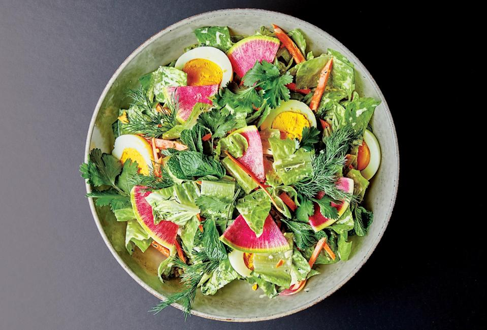 "This style of chopped salad is a staple of Hmong potlucks. This recipe, from chef Yia Vang, is packed with crunchy radishes and tossed with a creamy-umami dressing. <a href=""https://www.bonappetit.com/recipe/potluck-chopped-salad?mbid=synd_yahoo_rss"" rel=""nofollow noopener"" target=""_blank"" data-ylk=""slk:See recipe."" class=""link rapid-noclick-resp"">See recipe.</a>"