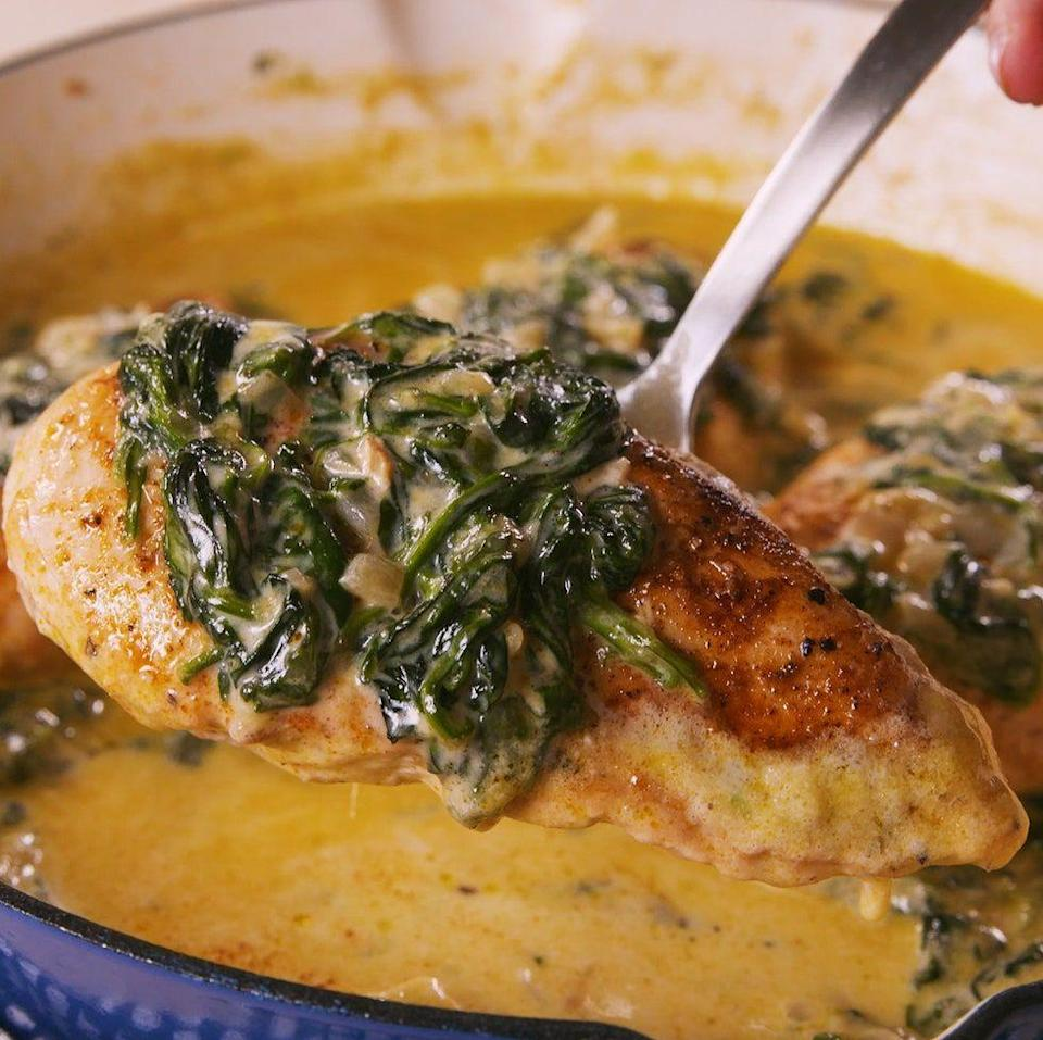 """<p>You'll be eating straight out of the pan. </p><p>Get the <a href=""""https://www.delish.com/uk/cooking/recipes/a30322691/creamed-spinach-chicken-recipe/"""" rel=""""nofollow noopener"""" target=""""_blank"""" data-ylk=""""slk:Creamed Spinach Chicken"""" class=""""link rapid-noclick-resp"""">Creamed Spinach Chicken</a> recipe.</p>"""