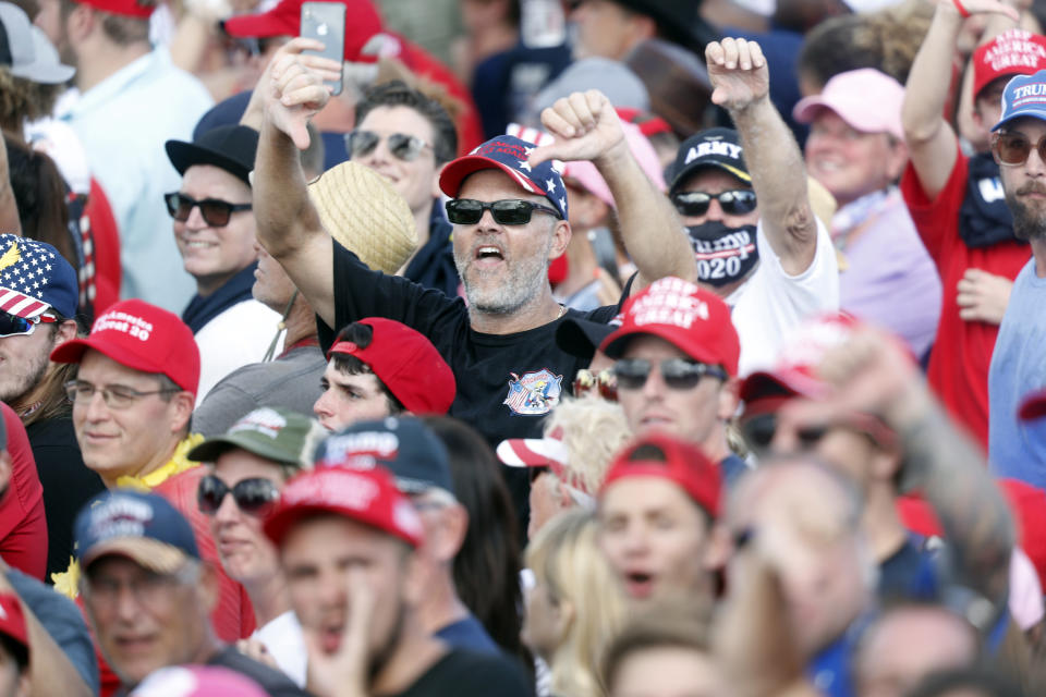 "Supporters of President Donald Trump show their disdain shouting ""CNN sucks"" during his campaign speech just four days before Election Day outside of Raymond James Stadium on October 29, 2020 in Tampa, Florida. (Octavio Jones/Getty Images)"