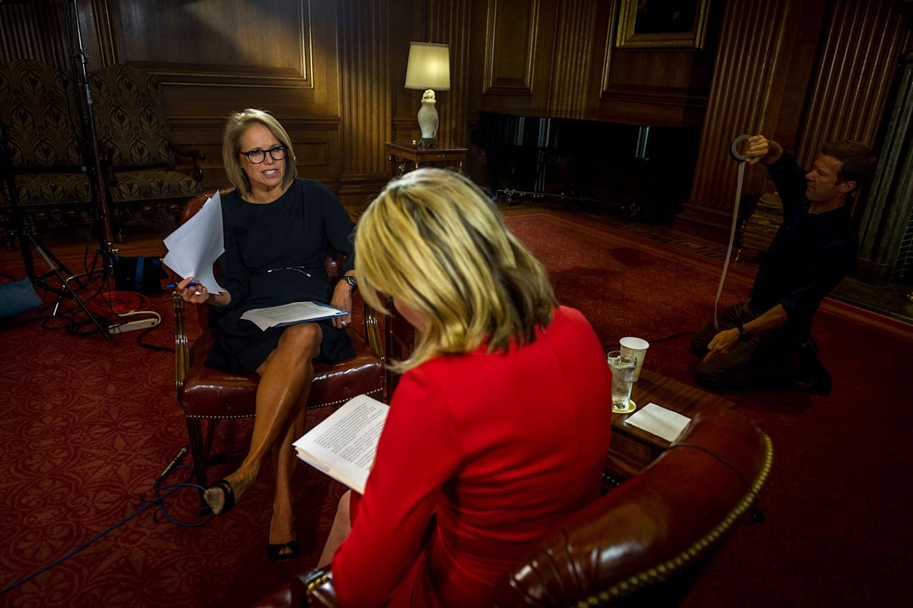 <p>Yahoo News Global Anchor Katie Couric and Yahoo News Associate Producer Sarah Boxer go over some notes while cameraman Brad Williams preps ahead of the interview with Ruth Bader Ginsburg, Sept. 30, 2016. (Photo: Mary F. Calvert for Yahoo News) </p>