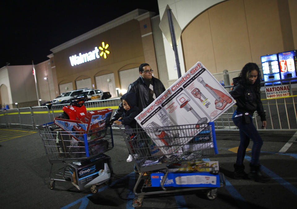 People pull loaded shopping carts at a Walmart store, on Thanksgiving day in North Bergen, New Jersey on November 22, 2012. REUTERS/Eric Thayer