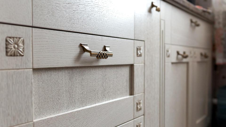 retro metal cabinet knobs in the kitchen.