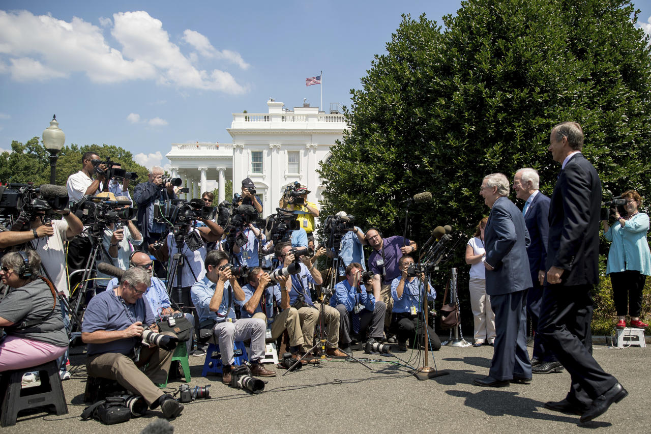 <p> From left, Senate Majority Leader Mitch McConnell of Ky., Senate Majority Whip John Cornyn of Texas., and Sen. John Thune, R-S.D., speaks to members of the media outside of the West Wing of the White House in Washington, Wednesday, July 19, 2017, following a luncheon with President Donald Trump and other GOP leadership. (AP Photo/Andrew Harnik) </p>
