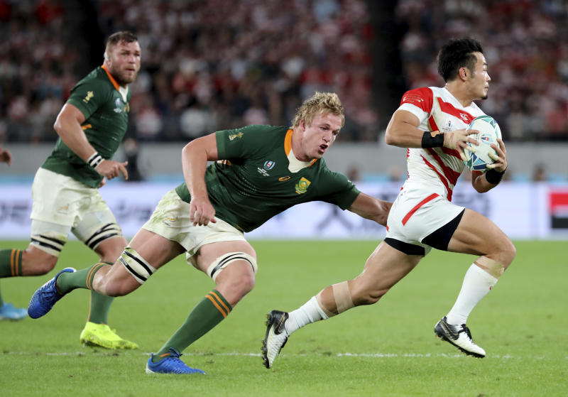 Japan's Kenki Fukuoka, right, is chased by South Africa's Pieter-Steph du Toit during the Rugby World Cup quarterfinal match at Tokyo Stadium in Tokyo, Japan, Sunday, Oct. 20, 2019. (AP Photo/Eugene Hoshiko)
