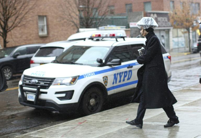 A police car patrols in Brooklyn on December 30, 2019 in New York City, two days after an intruder wounded five people at a rabbi's house in Monsey, New York during a gathering to celebrate Hanukkah