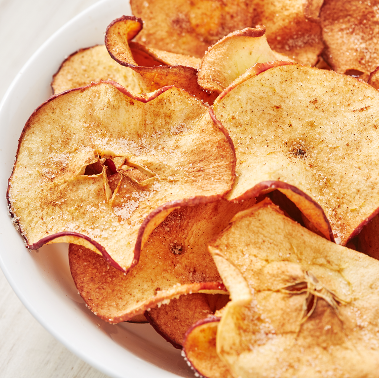 "<p>Making your own apple crisps is very easy and it's a delicious healthy snack to have on hand and not to mention, one of our favourite apple recipes. Use your favourite apple and try slicing them as thinly as you can. We like using a mandoline for even slices! The best part is that these are perfect both made in the oven or in air fryer! </p><p>Get the <a href=""https://www.delish.com/uk/cooking/recipes/a28995950/healthy-apple-chips-recipe/"" rel=""nofollow noopener"" target=""_blank"" data-ylk=""slk:Apple Crisps"" class=""link rapid-noclick-resp"">Apple Crisps</a> recipe.</p>"