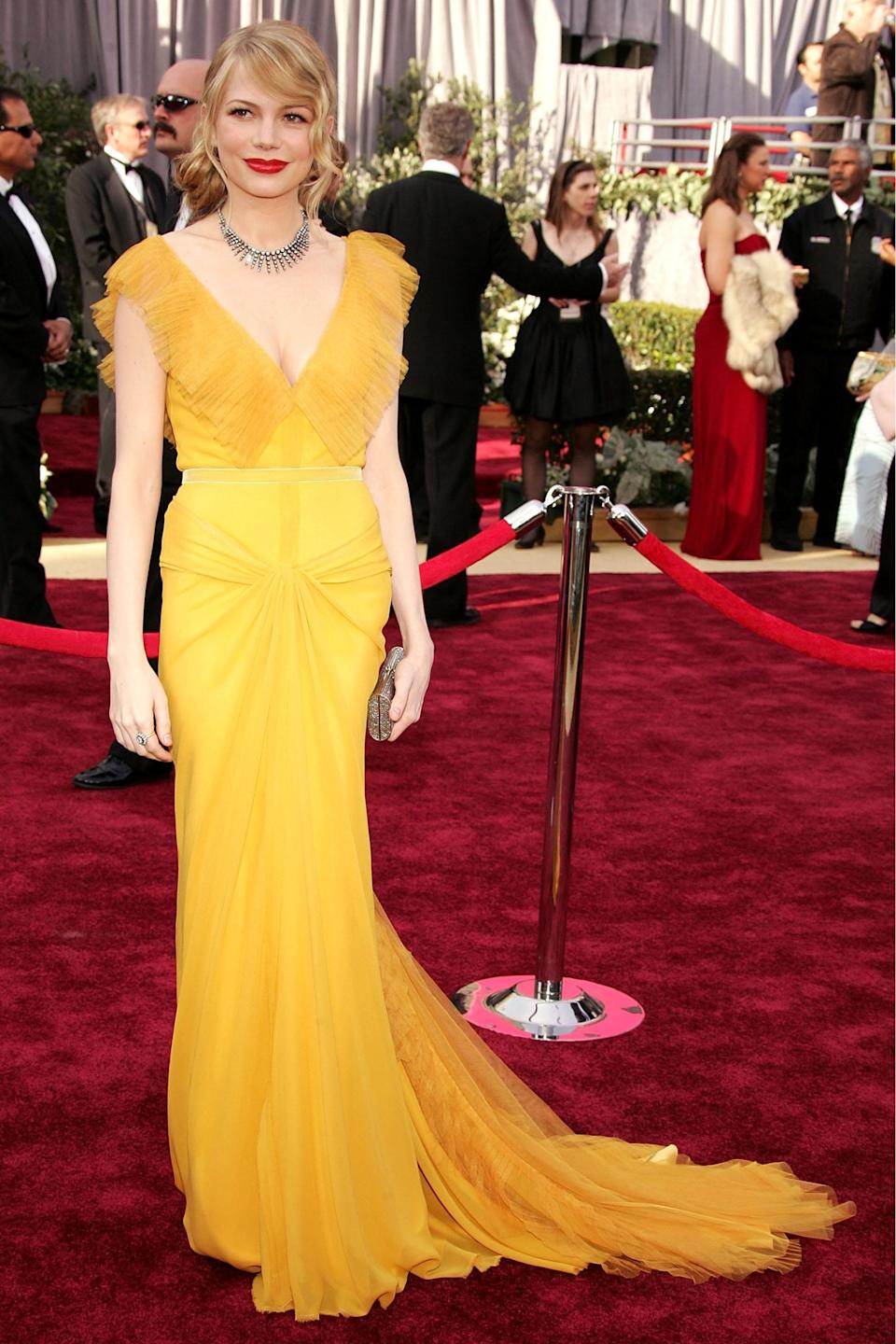 """<strong><h2>Michelle William, 2006</h2></strong><br>Accompanying her then-boyfriend, the late Heath Ledger, Michelle Williams was a shining ray of light in this yellow number by Vera Wang.<br><br><em>Michelle Williams in Vera Wang.</em><span class=""""copyright"""">Photo: Frazer Harrison/Getty Images. </span>"""
