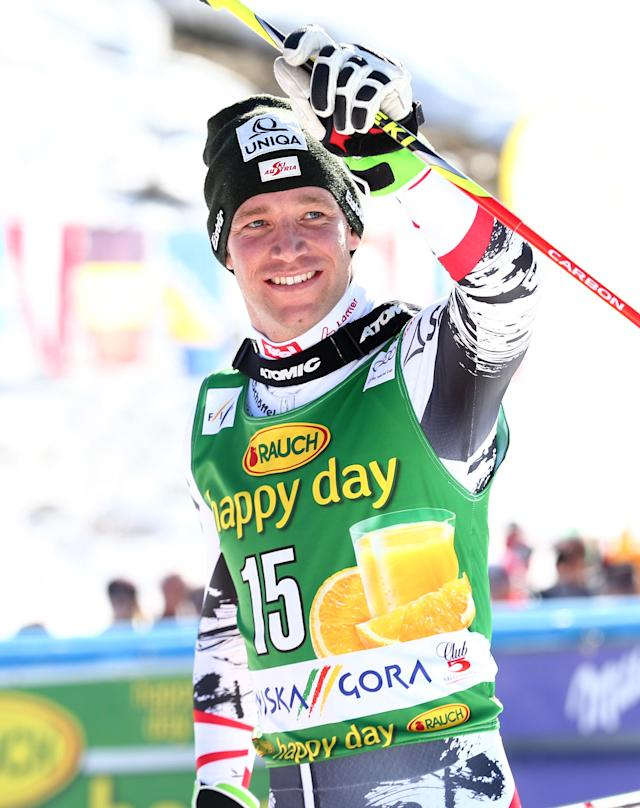 Benjamin Raich of Austria celebrates his second placed after an alpine ski men's World Cup giant slalom, in Kranjska Gora, Slovenia, Saturday, March 8, 2014. (AP Photo/Giovanni Auletta)