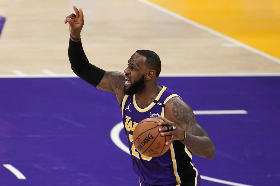 Los Angeles Lakers forward LeBron James directs the offense against the Sacramento Kings during the first half of an NBA basketball game Friday, April 30, 2021, in Los Angeles. (AP Photo/Marcio Jose Sanchez)