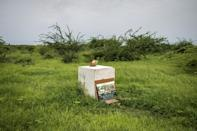 The project's first stone, laid a year ago, stands alone in a grassy field (AFP/JOHN WESSELS)