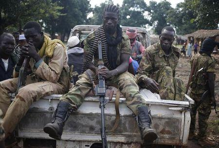 Seleka fighters take a break as they sit on a pick-up truck in the town of Goya