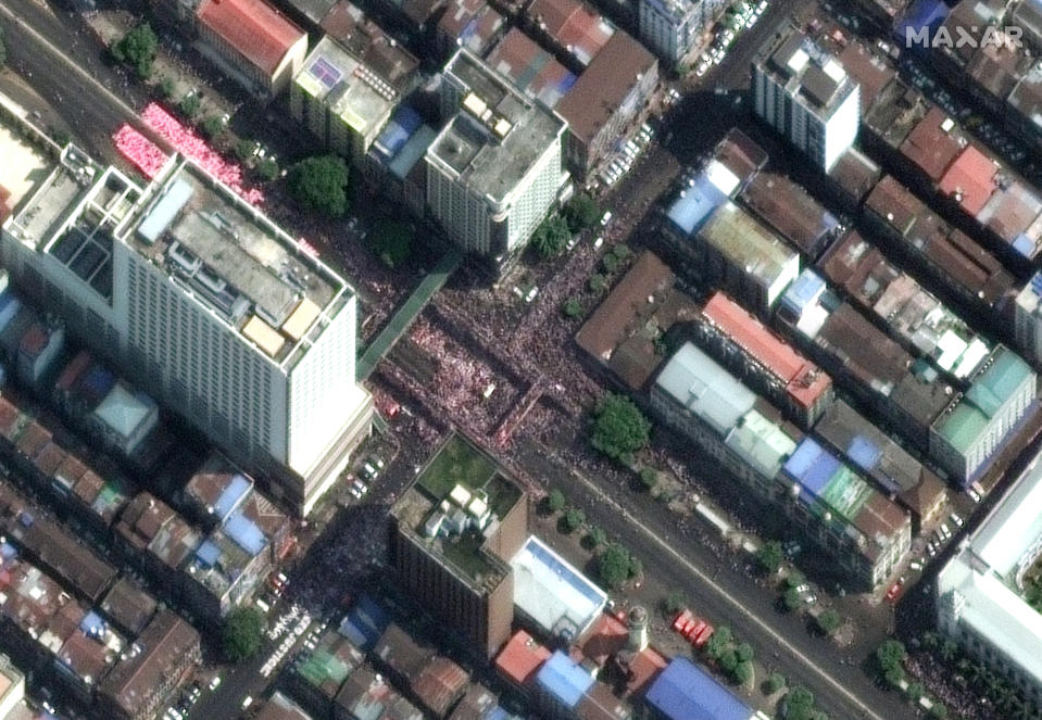 This satellite image provided by Maxar Technologies shows protesters near the City Hall in Yangon, Myanmar, Monday, Feb. 22, 2021. (Maxar Technologies via AP)