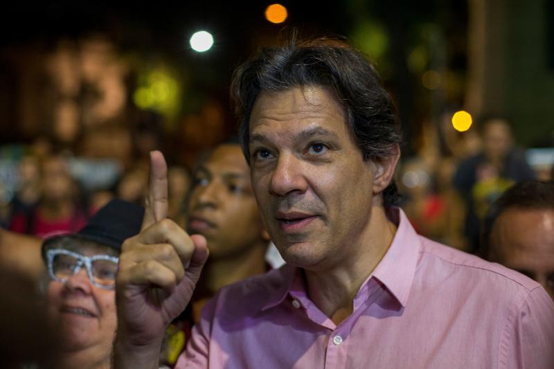 Sao Paulo's former Mayor Fernando Haddad gestures during a protest against Brazil's Bolsonaro Government education cuts and for Lula Livre (Free Lula) in Cinelandia Square, Rio de Janeiro, Brazil on May 10, 2019. - The Education Ministry announced a 30% budget freezing for federal institutions. (Photo by Daniel RAMALHO / AFP) (Photo credit should read DANIEL RAMALHO/AFP via Getty Images)