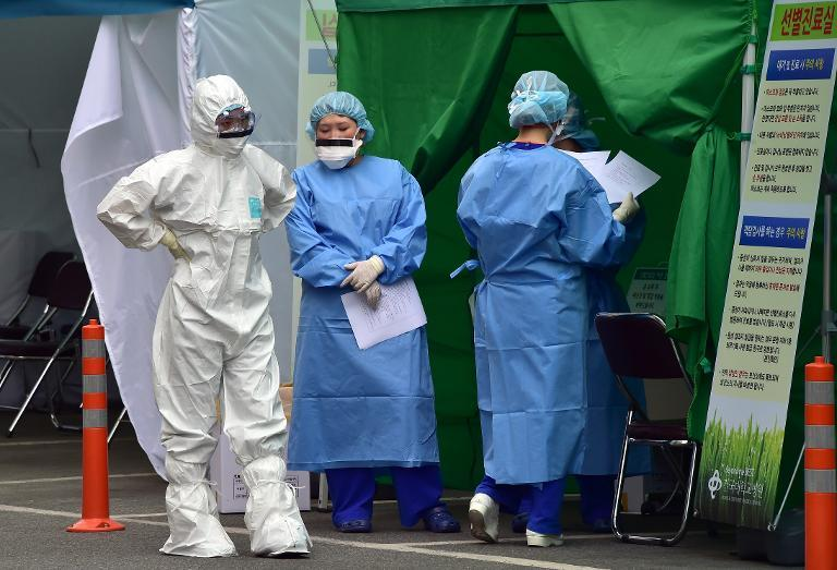Medical workers at a separated clinic centre at Seoul's Konkuk University Hospital, which has been set up to handle MERS cases, on June 24, 2015