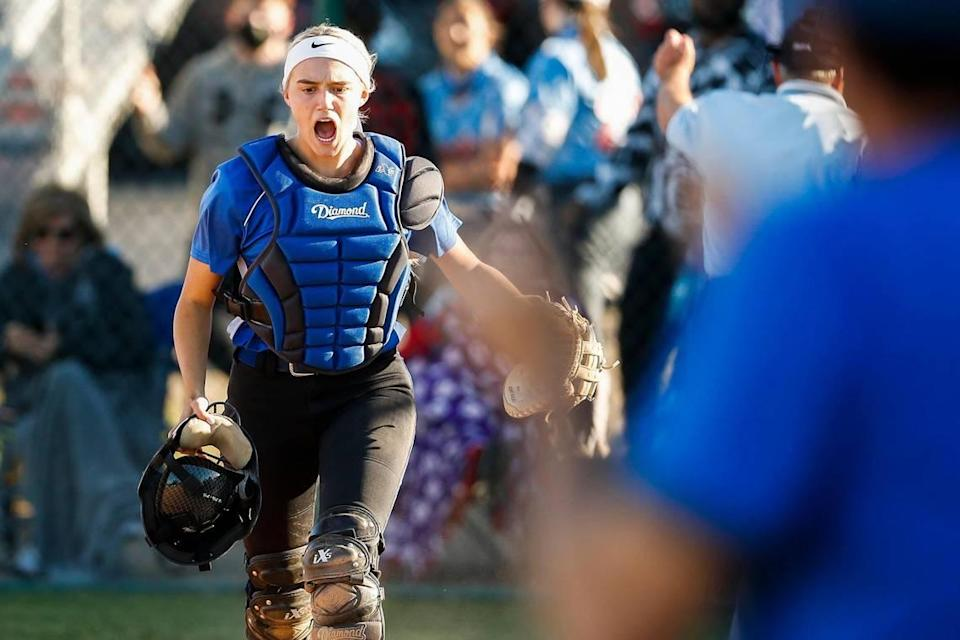 Lexington Catholic's Ella Emmert (12) celebrated during a game against Lafayette on Thursday. The Knights won 3-0.