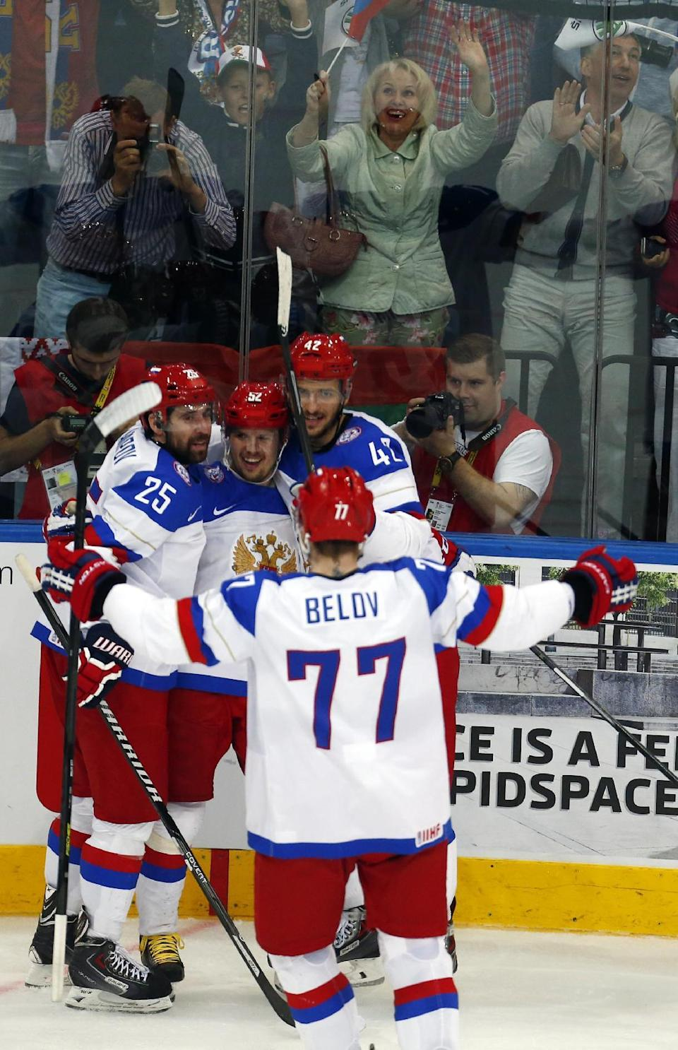 Russia forward Sergei Shirokov, second from left, celebrates a goal with Danis Zaripov (25), Artyom Anisimov (42) and Anton Belov (77) during the gold medal match against Finland at the Ice Hockey World Championship in Minsk, Belarus, Sunday, May 25, 2014. (AP Photo/Sergei Grits)