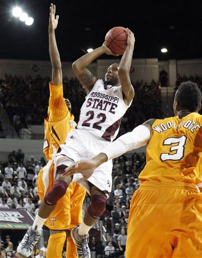 Mississippi State guard Brian Bryant (22) shoots over the attempted block by Tennessee guard Jordan McRae (52) as his teammate Renaldo Woolridge (3) looks on in the first half of their NCAA college basketball game in Starkville, Miss., Thursday, Jan. 12, 2012. (AP Photo/Rogelio V. Solis)