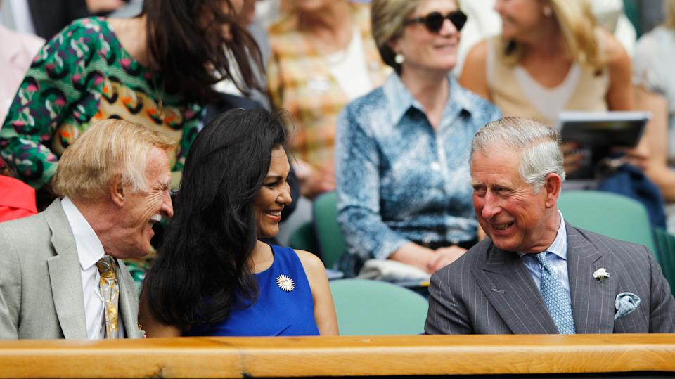 Prince Charles is joined by the late Sir Bruce Forsyth alongside Lady Winnie Forsyth as they watch Roger Federer take on Fabio Fognini in 2012. <em>[Photo: Getty Images]</em>