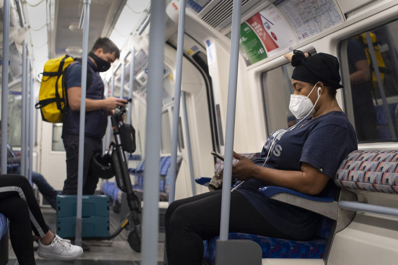 Commuters wearing face masks on the Jubilee line in central London, after the introduction of measures to bring the country out of lockdown.