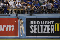 San Diego Padres center fielder Trent Grisham misses a fly ball hit by Los Angeles Dodgers' Will Smith during the fourth inning of a baseball game Friday, Sept. 10, 2021, in Los Angeles. (AP Photo/Ashley Landis)
