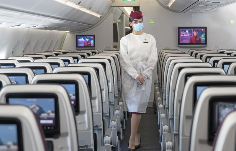 Qatar cabin crew will wear protective gowns as well as glasses, masks and gloves. Photo: Qatar Airways (supplied.)