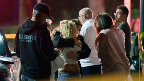 PHOTO: People comfort each other as they stand near the scene, Nov. 8, 2018, in Thousand Oaks, Calif., where a gunman opened fire Wednesday inside a country dance bar crowded with hundreds of people on 'college night.' (Mark J. Terrill/AP)