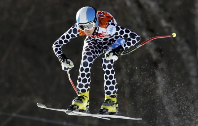 Argentina's Macarena Simari Birkner goes airborne during the downhill run of the women's alpine skiing super combined event at the 2014 Sochi Winter Olympics at the Rosa Khutor Alpine Center February 10, 2014. REUTERS/Stefano Rellandini (RUSSIA - Tags: OLYMPICS SPORT SKIING)