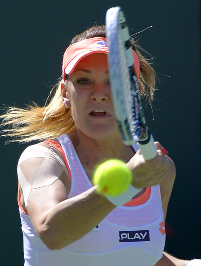 Agnieszka Radwanska, of Poland, returns a volley during a second round match at the BNP Paribas Open tennis tournament against Heather Watson, of Great Britain, Friday, March 7, 2014 in Indian Wells, Calif. (AP Photo/Mark J. Terrill)