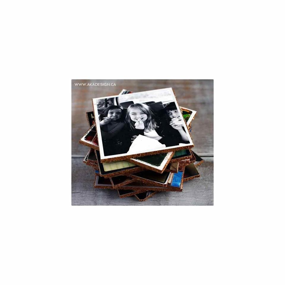 """<p>Here's a creative way to get your favorite snapshots off of your camera roll and on display: photo coasters. It's a cool and highly functional gift he's sure to love. </p><p><a href=""""https://homemadelovely.com/show-off-your-photos-diy-photo-coasters/"""" rel=""""nofollow noopener"""" target=""""_blank"""" data-ylk=""""slk:Get the tutorial."""" class=""""link rapid-noclick-resp"""">Get the tutorial. </a></p><p><a class=""""link rapid-noclick-resp"""" href=""""https://www.amazon.com/CS11201-Mod-Podge-8-Ounce-1-Pack/dp/B003W0XR8M?tag=syn-yahoo-20&ascsubtag=%5Bartid%7C10072.g.27603456%5Bsrc%7Cyahoo-us"""" rel=""""nofollow noopener"""" target=""""_blank"""" data-ylk=""""slk:SHOP MOD PODGE"""">SHOP MOD PODGE</a></p>"""