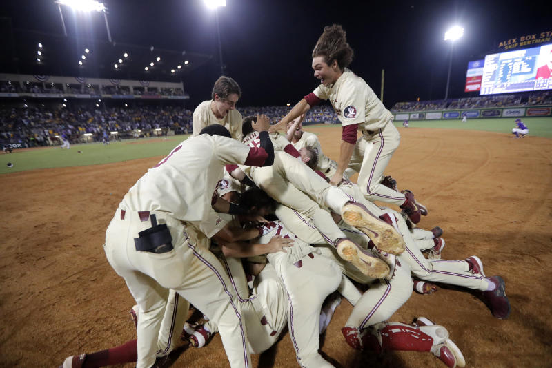 Florida State players celebrate after defeating LSU in 12 innings in Game 2 of the NCAA college baseball super regional tournament in Baton Rouge, La., Sunday, June 9, 2019. Florida State won 5-4 to advance to the College World Series. (AP Photo/Gerald Herbert)