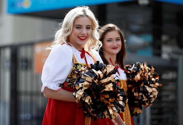Soccer Football - World Cup - Group A - Russia vs Saudi Arabia - Luzhniki Stadium, Moscow, Russia - June 14, 2018 Cheerleaders in traditional dresses outside the stadium before the match REUTERS/Carl Recine