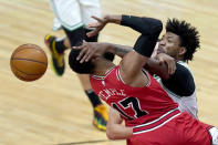 Boston Celtics' Marcus Smart, right, blocks the shot of Chicago Bulls' Garrett Temple during the second half of an NBA basketball game Monday, Jan. 25, 2021, in Chicago. (AP Photo/Charles Rex Arbogast)