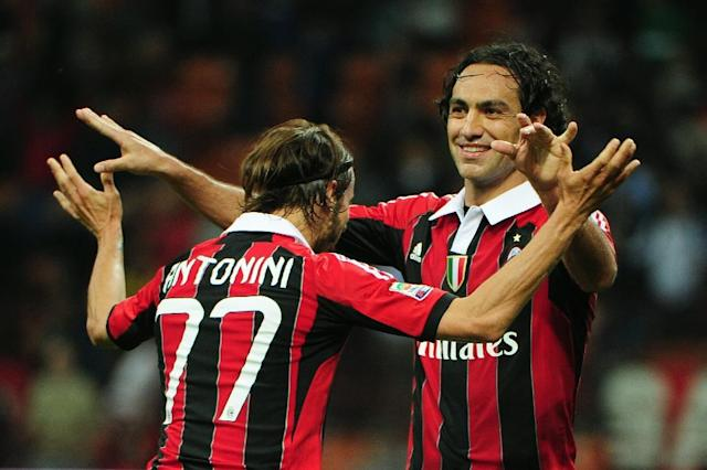 Alessadnro Nesta (R), pictured in 2012, was one of the greatest defenders of his generation, starting his career with boyhood club Lazio and also playing with AC Milan (AFP Photo/OLIVIER MORIN)
