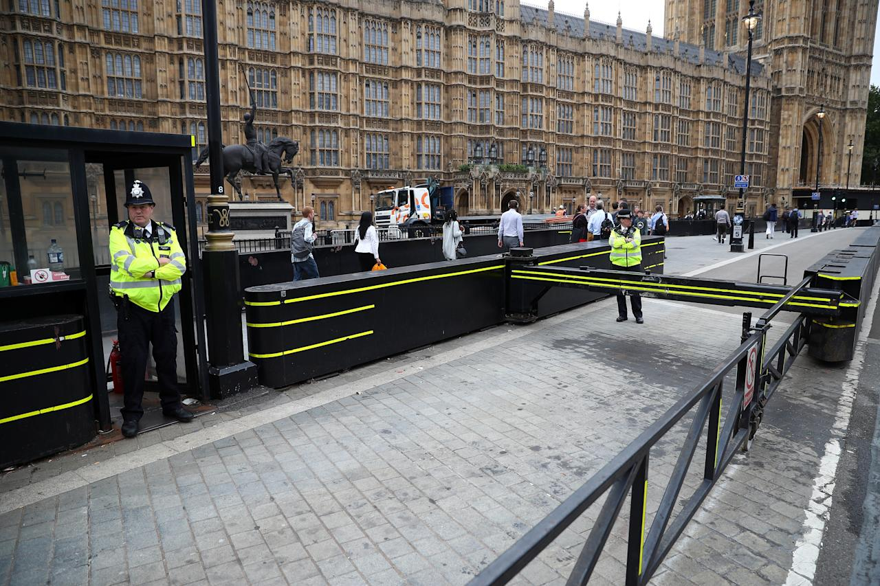 <p>Police officers stand at the vehicle barrier to the Houses of Parliament where a car crashed after knocking down cyclists and pedestrians yesterday in Westminster, London, Britain, Aug. 15, 2018. (Photo: Hannah McKay/Reuters) </p>
