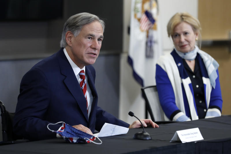 Texas Gov. Greg Abbott responds to a question as Dr. Deborah Birx, White House coronavirus response coordinator, looks on during a news conference after Vice President Mike Pence met with Abbott and members of his healthcare team regarding COVID-19 at the University of Texas Southwestern Medical Center West Campus in Dallas, Sunday, June 28, 2020. (AP Photo/Tony Gutierrez)