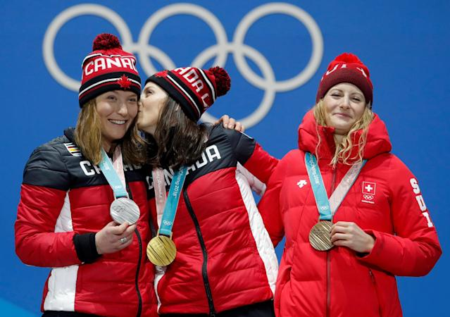 Medals Ceremony - Freestyle Skiing - Pyeongchang 2018 Winter Olympics - Women's Ski Cross - Medals Plaza - Pyeongchang, South Korea - February 23, 2018 - Gold medalist Kelsey Serwa of Canada, silver medalist Brittany Phelan of Canada and bronze medalist Fanny Smith of Switzerland on the podium. REUTERS/Eric Gaillard TPX IMAGES OF THE DAY