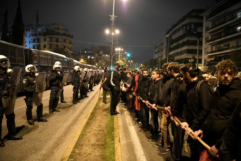The Athens march was closely flanked by riot police (AFP Photo/LOUISA GOULIAMAKI )