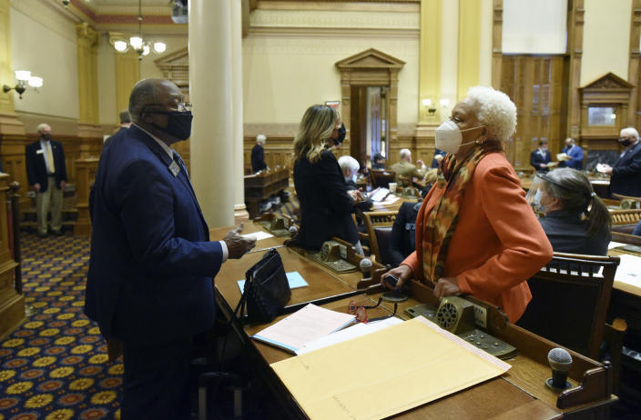 """FILE - In this Tuesday, Jan. 12, 2021, file photo, State Sens. Ed Harbison, left, D-Columbus, and Minority Leader Gloria Butler, D-Stone Mountain, confer inside the Senate Chambers during the second day of the 2021 legislative session at the Georgia State Capitol, in Atlanta. Butler says some achievements in Georgia's 2021 session were """"progress,"""" but says good work was """"overshadowed"""" by the state's new voting law and other Republican priorities. (Hyosub Shin/Atlanta Journal-Constitution via AP, File)"""