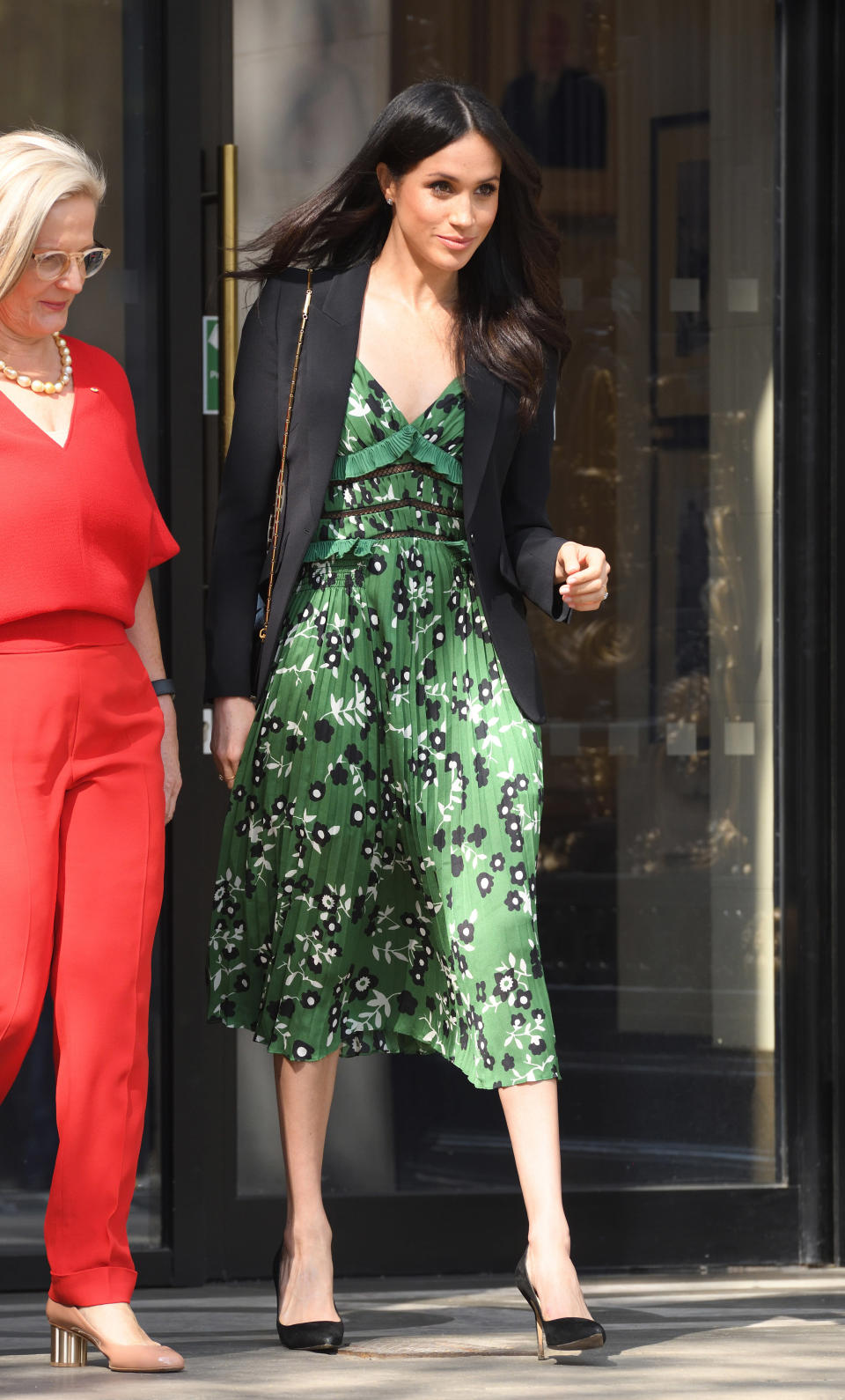 <p>Markle stunned in a springtime ready cold-shoulder dress by Self Portrait, which retails for around $510 CAD. It's currently still in stock at a number of retailers — but that probably won't be the case for long! </p>